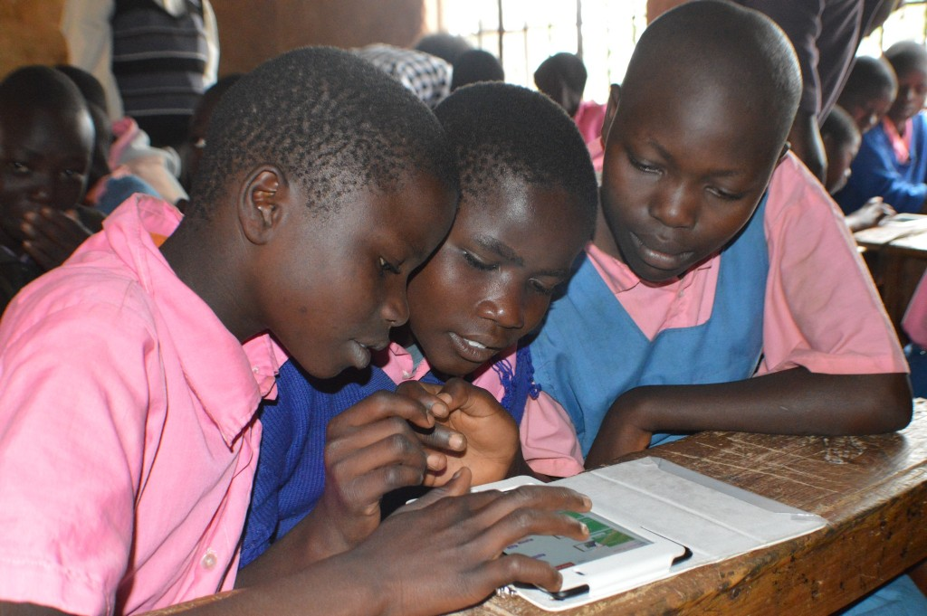 Standard 4 pupils from Wekhonye Primary School using tablets to access educational content from RACHEL.
